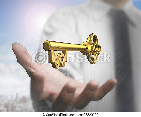 Handfläche mit goldenem Schatzschlüssel. - csp38820030
